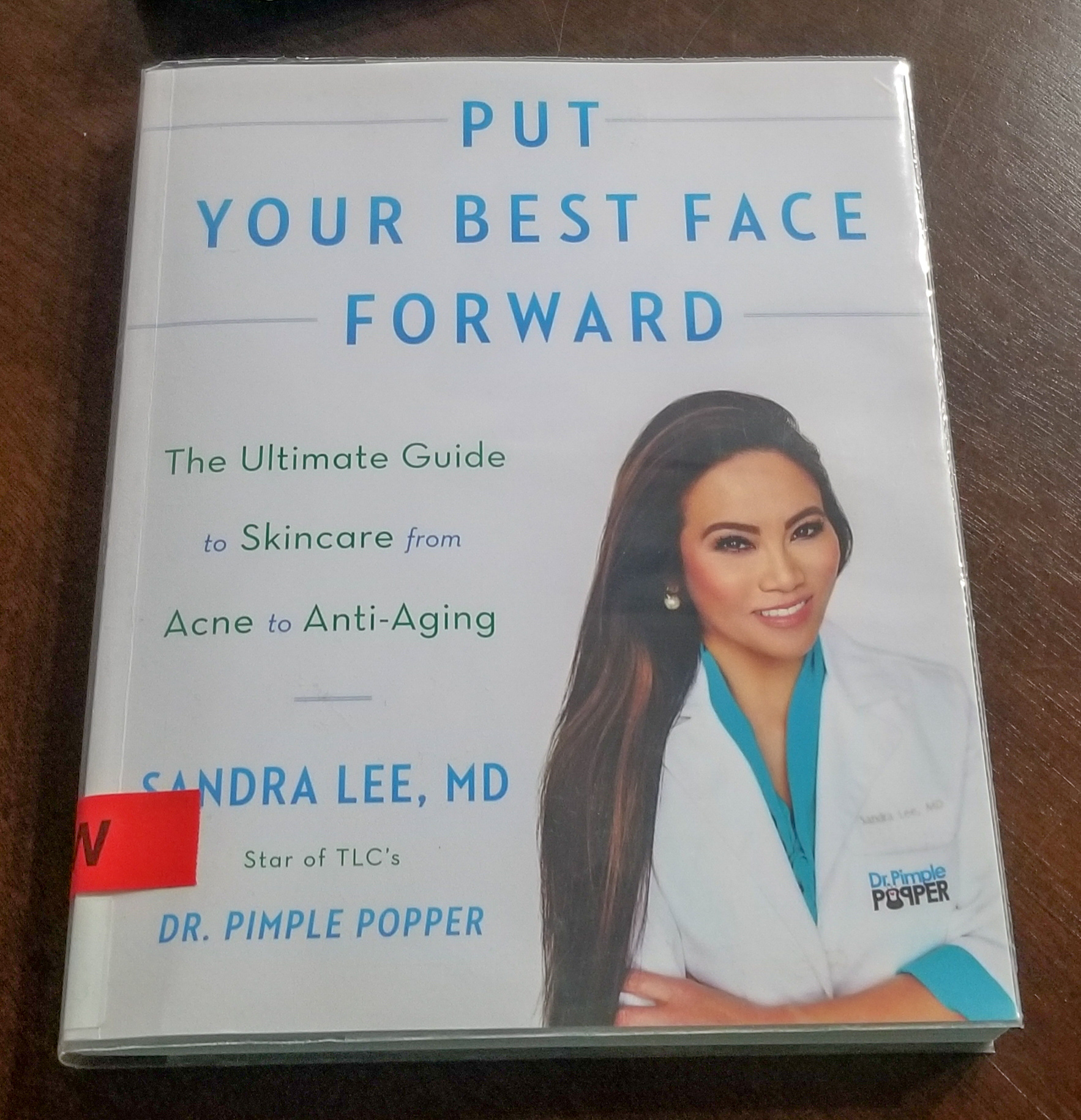 Dr  Pimple Popper wrote a book and I love it as much as the show, if